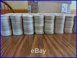 1,000 Paulson Top Hat and Cane Clay poker chips from Gold Star Casino
