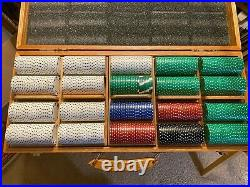 Poker chip set in wood case. There are 497 12gm clay chips in 5 colors